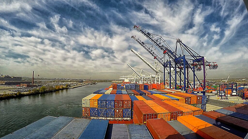 Containers on cranes in export terminal port
